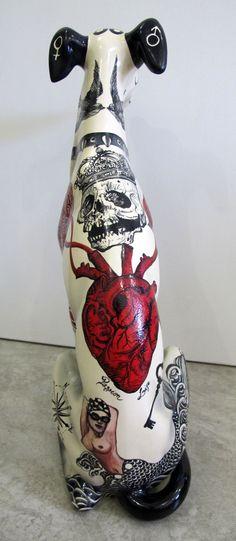 tattooed dog statue