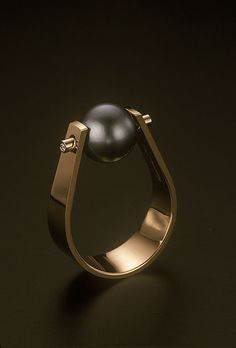Richard Messina's exquisitely crafted gold forged band with captured south seas pearl flanked with two diamonds    http://messinadesigns.com/rmd/gallery.asp?t=r