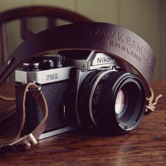 Our brown Borough camera neck strap with the elegant Nikon FM2. by hawkesmillbags