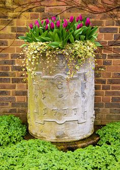 Must find an alternative to achieve this aged beauty for my columnar container garden. Maybe use a concrete pier form with wire mesh on the outside and slather on a thick hypertufa and impress a pattern. Garage door flexible trim for raised detail...