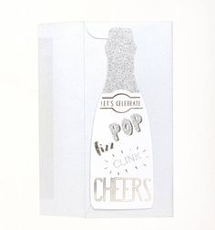 Pop, fizz and clink your way to any celebration with this snazzy champagne bottle shaped card. This card features alternating gold foil and silver glitter. This card also doubles as a gift topper or champagne bottle tag. Simply punch a hole through the card at the top and insert