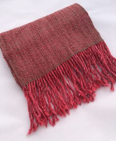 Hand dyed pink warp using a beautiful merino/alpaca 50/50 yarn base. The color varies in richness from a medium to a saturated pink giving the scarf a feminine, but still sophisticated look. The pink is paired with a luscious cashmere/mink yarn in a dark oatmeal, woven in a diamond pattern.