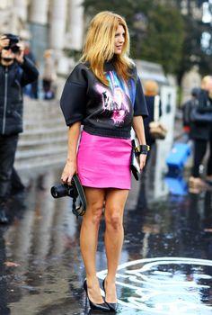 Tanja Gacic in BALENCIAGA sci-fi sweatshirt and magenta mini skirt.