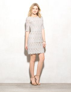 One way to freshen up your wardrobe this season? A lace dress keeps things effortlessly chic. Complete the look with your favorite neutral shoes and a bracelet or two! Imported.