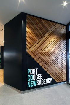 Situated at the entry of Port Coogee's newly built main shopping centre, Masterplanners was responsible for a fitout that met both the design brief of the client and supported the overall image and brand message of the shopping centre. Wood Wall Design, Feature Wall Design, Wall Panel Design, Ceiling Design, Signage Design, Facade Design, Wood Interiors, Office Interiors, Office Interior Design