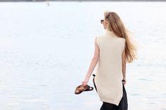 Sirma Markova: Sheer pleats, sleeveless sweater and minimal jewelry