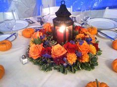 Fresh flowers and a lantern in an autumn centerpiece