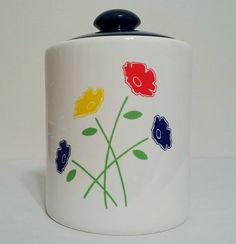 White canister blue lid flowers poppies cookie by AtomicPhenomic