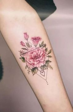 One of the most prominent tattoo trends in recent years is geometric designs. Adding shapes – such as triangles and squares – as well as dots, lines, and patterns to your tattoo can give it a unique and futuristic style. Flowers look great with geometric elements because of the contrast between the angular shapes and the soft, organic curves of the flower. Beautiful Flower Tattoos, Beautiful Flowers, Small Tattoo Designs, Small Tattoos, Random Tattoos, Phönix Tattoo, Tattoo Kits, Bouquet Tattoo, Initial Tattoo
