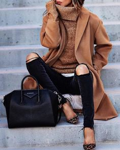 Sasha Simon wears this gorgeous overcoat style camel coat with distressed black skinny jeans, a knitted polo neck sweater, and a pair of statement heels to inject some colour into the outfit. Brands not specified.