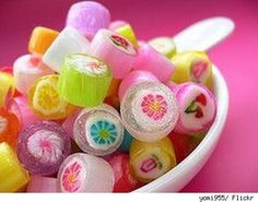 japanese candy | bowl of cute Japanese candy with a pink background.
