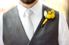 simple yellow boutonniere, gray striped tie // Images by Studio Elle Photography