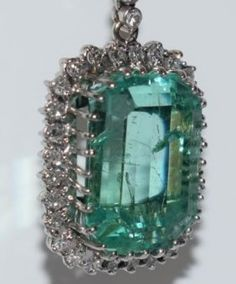 Emerald diamond pendant with 26 carat, 750 white gold