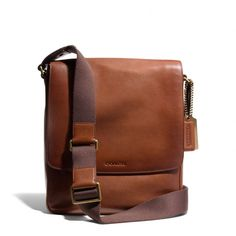 The Bleecker Map Bag In Leather from Coach. Who says this has to be for men?  Perfect size for a purse for me!