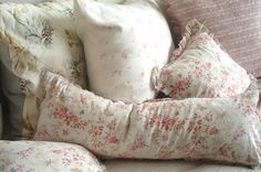 Feather pillow in rose patterned ticking