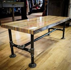 """Butcher Block Slab Table, 2013  This coffee table contains sections of over 120 skateboards.  Dimensions: 20""""Wide X 48""""Long X 17""""High  The legs of"""