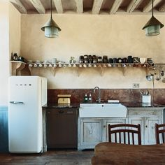as we dream about our future farm house, white kitchens with lots of wood seem to always win