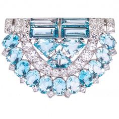 Cartier London Art Deco  Aquamarine Diamond Clip Brooch. A very fine Art Deco aquamarine and diamond clip brooch by Cartier London of geometric design, set with oval, baguette and kite-shaped aquamarines and circular cut diamonds, mounted in platinum. Signed Cartier London. In original Cartier fitted case. c 1930