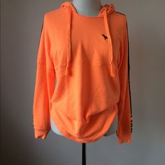 Victoria Secret pink boyfriend varsity hoodie BOYFRIEND VARSITY CREW HOODIE Size small OVERSIZED FIT,LONGER TUNIC LENGTH,SUPER SOFT FLEECE, BLACK GRAPHICS, BRIGHT COLOR AND COTTON BLEND Neon Orange color PINK Victoria's Secret Tops Sweatshirts & Hoodies