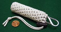 Glow in the dark paracord holds flashlight