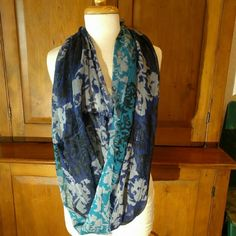 Big Buddha Infiniti Scarf Pretty Blues with silver threads run throughout this tropical floral infinity scarf! Great for styling many different ways. 100% Polyester NWOT Big Buddha Accessories Scarves & Wraps