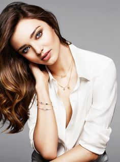 Miranda Kerr wears a white button-down shirt with jewelry of her own design for Swarovski