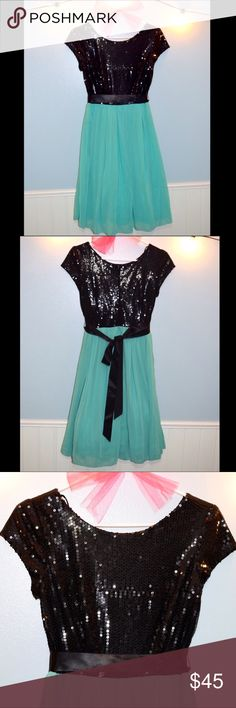 Like New Black Sequin Top Dress Black sequin top dress with empire waistline flowing into a teal chiffon skirt. Tag reads size 5/6 and I'd say it's true to size!  Skirt features three layers, chiffon layer, teal lining, and a tulle underskirt. Wear the black bow anywhere on the dress to match your style! Style with your favorite heels and elegant earrings for any formal event, or even style to wear at a semi-formal event! Dresses Midi