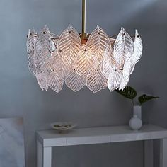 Glass Leaf Chandelier ..... love the idea of a chandelier or interesting light in the bedroom