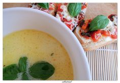Cheese soup with white wine and crispy croutons a'la bruschetta .