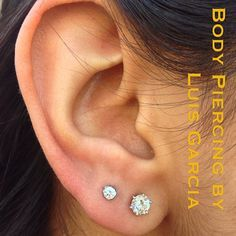 Fresh second earlobe piercing with Anatometal 3mm prong set CZ (at NoKaOi Tiki Tattoo and Piercing)