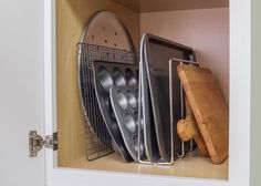 Tray Organizer- U-Shaped Tray Organizer is great for organizing baking sheets, muffin tins, cutting boards and pizza pans. Use two or more to organize in wider cabinets. Mounts to the bottom of cabinet with 4 screws (screws included). Polished Chrome. Retail packaged. (Item # TD-PC-R)