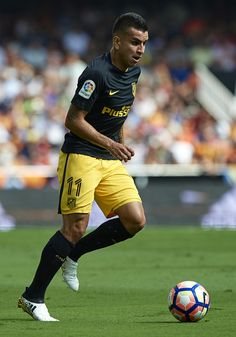 Angel Martin Correa of Atletico de Madrid runs with the ball during the La Liga match between Valencia CF and Atletico de Madrid at Mestalla Stadium on October 02, 2016 in Valencia, Spain.