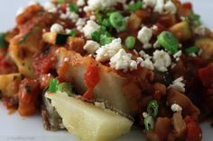 Hearty Vegetarian Chili Baked Potato with Feta.- or cheddar, or whatever...we had these last week with kale salad...so good