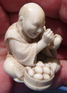 """""""The egg tester"""" Japanese 19th C. netsuke figure"""