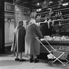 Shopping in Wilson Bros butchers 1960s. This is now the lobby of the Young Vic theatre, tiles still there.
