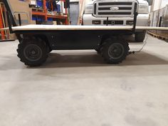 Expandable deck for carrying plywood sheets Electric Utility, Electric Motor, Chain Drive, Plywood Sheets, Pug, Pallet, Monster Trucks, Deck, Platform