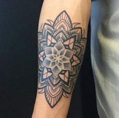 With the stippling effect in the center mandala and then bolder designs going outward, this mandala tattoo by Nghia Chung is truly superb.