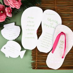 """Island adventure beach theme wedding invitations.Great for summer weddings this sandal-shaped invitation is accented with tropical flora and stripes. When folded, your first names will be printed on the front, while your choice of quote will be printed on the inside left. The note, """"See you there!"""" will be printed on the back. Choose from five sandal strap ribbon colors for the front and back"""