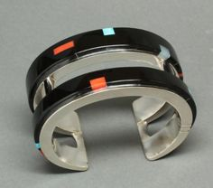 Richard Chavez (San Felipe Pueblo)   Black Jade Bracelet is made of double silver with black jade inlay, candelaria turquoise inlay, and white jade inlay.