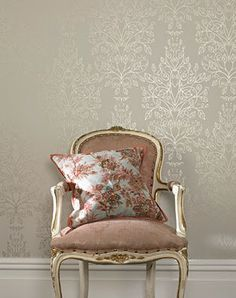 Fabulous wallpaper. The chair and cushion complements it perfectly.