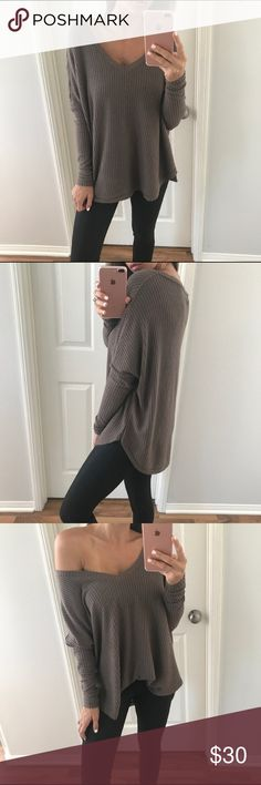 | boutique | top Amazing mocha color waffle top. Can be worn off the shoulder or not. V neck. This is one size fits all so it's a dolman loose fit. Sleeves are fitted.  It's a must have! Originally purchased from Allie @mrsalliexo photo credit to her for first 4 photos. New with tags. 63% polyester 33% rayon 4% spandex Boutique Tops