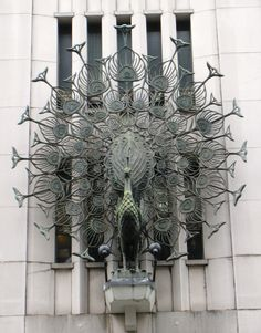 stunning cast peacock on building...