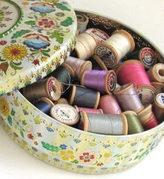 Vintage tin sewing box... my mother had one with this pattern on a black background
