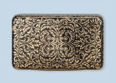 AN ANTIQUE ENAMEL SNUFF BOX   The rectangular box finely black enamelled with acanthus foliage, Austrian-Hungarian, circa 1830