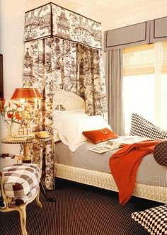 I can appreciate these layers....toile  and checks with wicker,  canopy and 2 colours. Quirky and balanced.