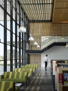 Craigieburn Library combines rammed earth walls with slatted canopies