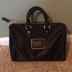 """Victoria Secret handbag Vinyl material handbag. Lining is pink. Gold zipper. Inside has one zippered pocket. Perfect condition. No rips or stains. Never used. 11"""" wide. 8 1/2"""" tall and 5"""" deep. Victoria's Secret Bags Satchels"""