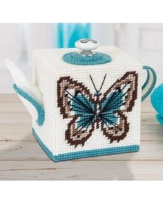 Butterfly Teapot Tissue Box Cover Plastic Canvas Kit: Make this plastic canvas tissue box cover using our kit. Plastic Canvas Box Patterns, Plastic Canvas Coasters, Plastic Canvas Stitches, Plastic Canvas Ornaments, Plastic Canvas Tissue Boxes, Plastic Canvas Crafts, Butterfly Crafts, Butterfly Canvas, Button Crafts