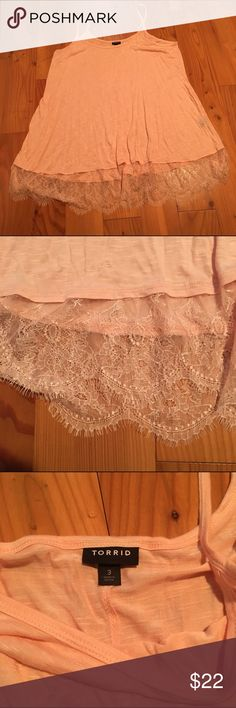NWOT Torrid Lace Bottom Tank Brand new, never worn, without tags. Peach colored spaghetti strap tank top with a flowy design. Peach and cream lace at the bottom of the tank all the way around. Comfortable and cute! True color shown in second photo torrid Tops Tank Tops