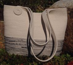Coiled clothesline rope bag, rope art by Andrea